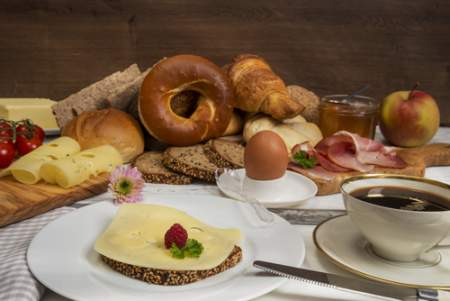 Table with bagels, eggs, cheese, coffee